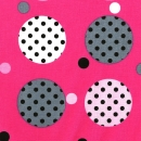 Gepunktete Kreise auf pinkfarbenem Hintergrund