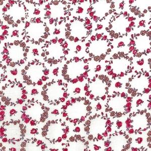 Kleine rote Blütenkränze auf ecru