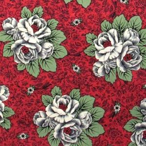 Rosen mit Blättern auf rotem Hintergrund